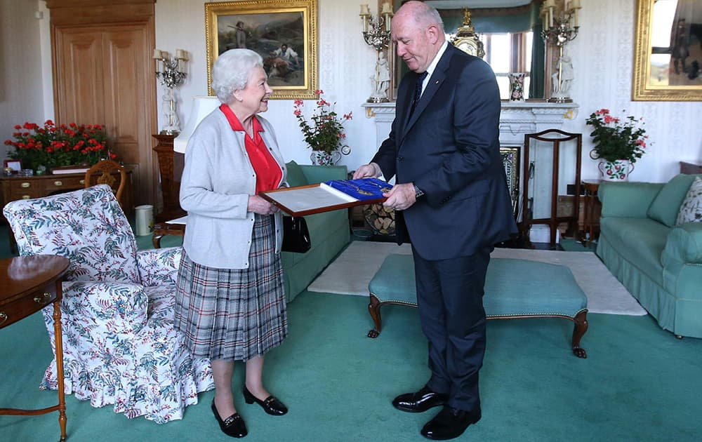 Britain`s Queen Elizabeth II presents the honour of Knight of the Order of Australia to Australian Governor-General Peter Cosgrove, in Balmoral, Scotland.