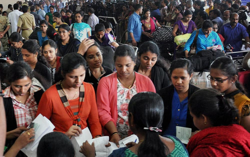 The batch of 44 Kerala nurses, evacuated from Libya, on their arrival at the airport in Kochi.