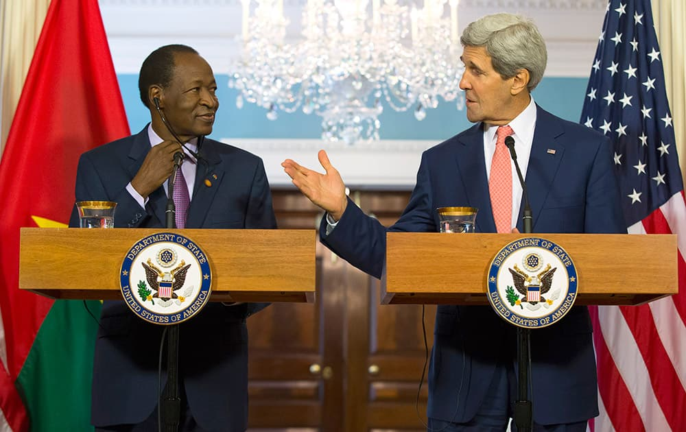 Secretary of State John Kerry and Burkina Faso President Blaise Campaoré participate in a joint news conference before a bilateral meeting during the US Africa Leaders Summit, at the State Department in Washington.