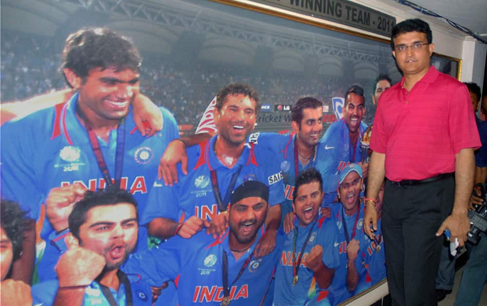 Former Indian cricket captain Sourav Ganguly poses before a poster of the 2011 World Cup winning Indian team after being elected the Joint Secretary of CAB (Cricket Association of Bengal) in Kolkata.