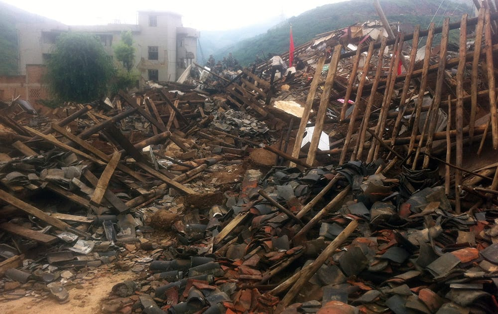 Rescue workers search for survivors in the epicenter of an earthquake that struck the town of Longtoushan in Ludian county in southwest China`s Yunnan province.
