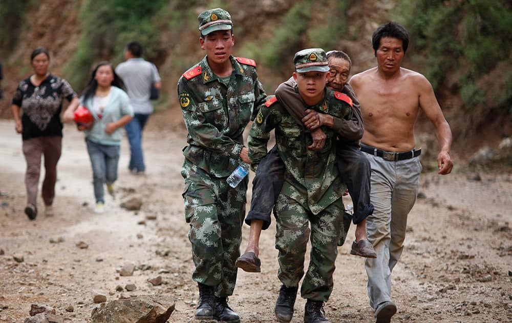 Rescuers transport injured people after an earthquake in Zhaotong City in the densely populated Ludian county in southwest China`s Yunnan Province.