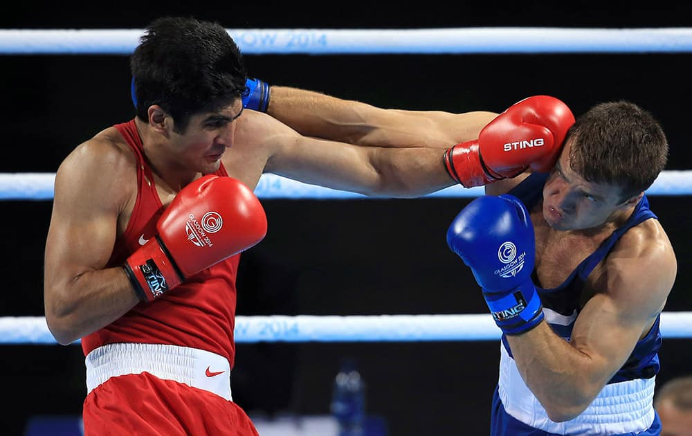 England`s Antony Fowler, right, and India`s Vijender Vijender fight in the men`s middleweight 75kg final during the 2014 Commonwealth Games in Glasgow, Scotland.
