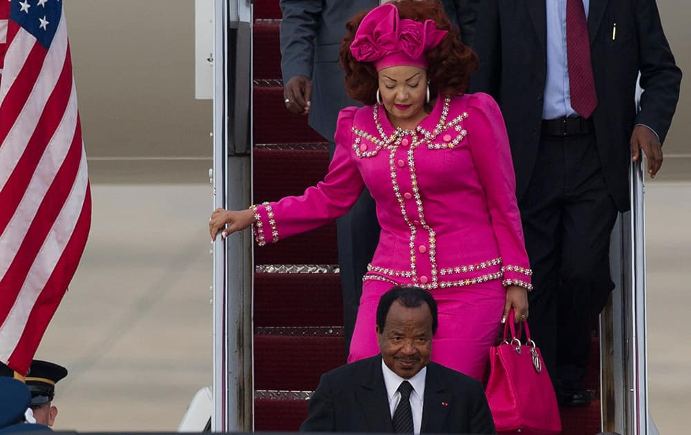 Cameroon President Paul Biya and his wife Chantal arrive at Andrews Air Force Base, Md., for the US-Africa Leaders Summit.
