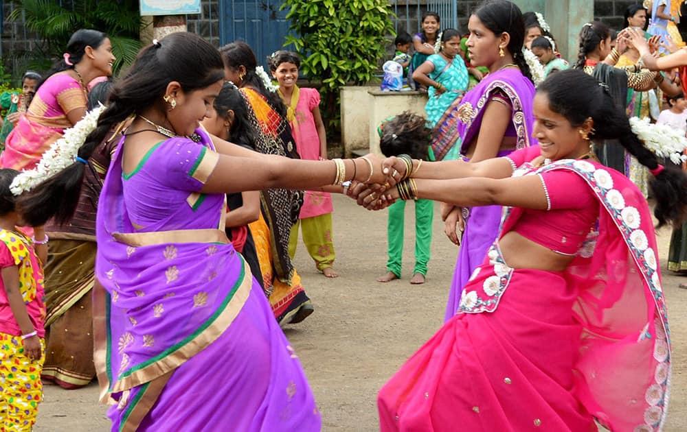 Women dance as they celebrate the festival of `Nag Panchmi` in Karad, Maharashtra.