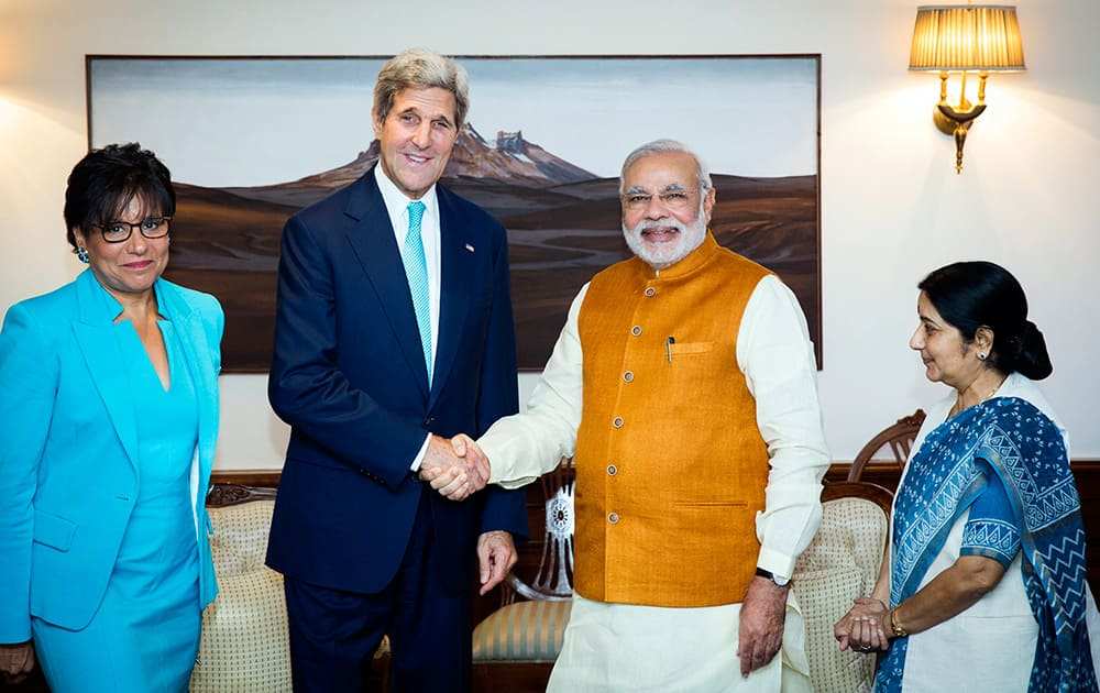 US Secretary of State John Kerry shakes hands with Indian Prime Minister Narendra Modi, as Indian Foreign Minister Sushma Swaraj and US Secretary of Commerce Penny Pritzker stand by their sides at Modi`s residence in New Delhi.