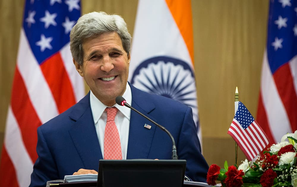 US Secretary of State John Kerry laughs as he answers a question during a press conference addressed jointly with Indian Foreign Minister Sushma Swaraj in New Delhi.