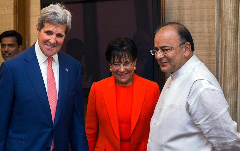 US Secretary of State John Kerry and US Secretary of Commerce Penny Pritzker, stand with Indian Finance and Defense Minister Arun Jaitley in New Delhi.