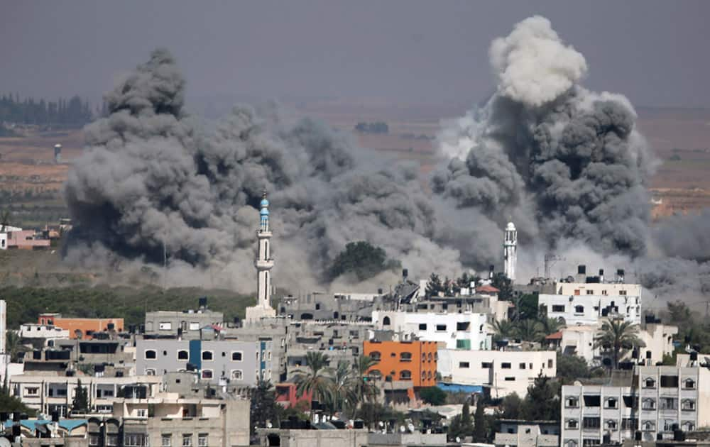 Smoke rises after an Israeli strike in Gaza City, northern Gaza Strip.