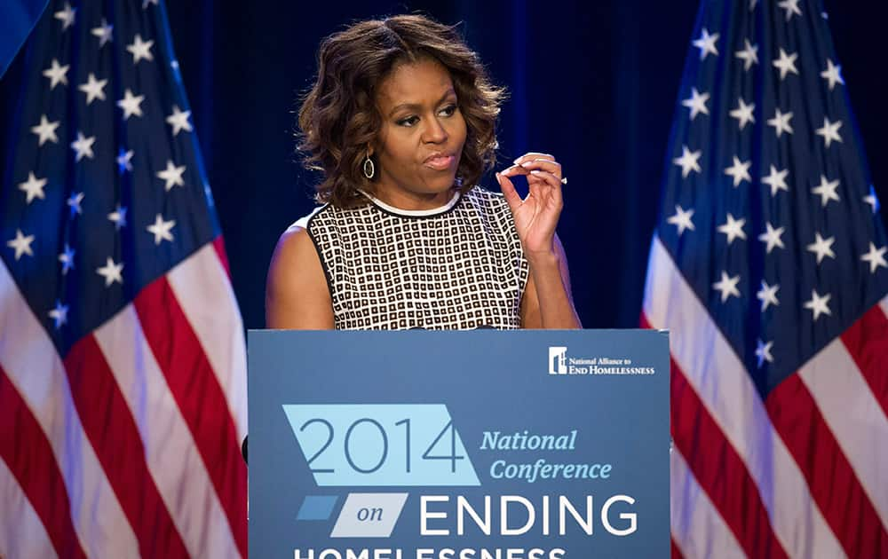 First lady Michelle Obama speaks at the 2014 National Conference on Ending Homelessness, part of the Joining Forces initiative, in Washington.