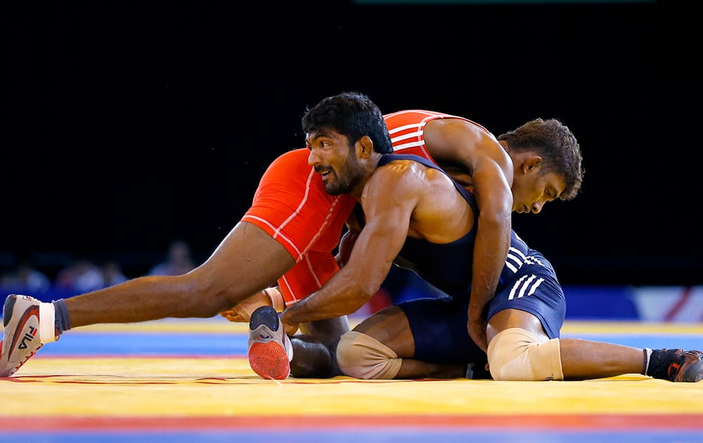 Yogeshwar Dutt of India wrestles with Chamara Perera of Sri Lanka during a men`s FS 65kg semifinal wrestling bout at the Scottish Exhibition Conference Centre during the Commonwealth Games 2014 in Glasgow, Scotland.