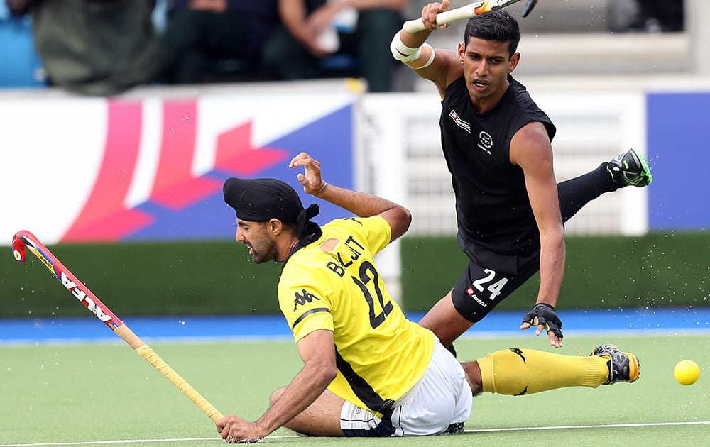 New Zealand`s Arun Panchia vies for the ball with Mayalsia`s Bajiit Charun Singh during their men`s field hockey match at the Commonwealth Games Glasgow 2014, at the National Hockey Centre, Glasgow, Scotland.
