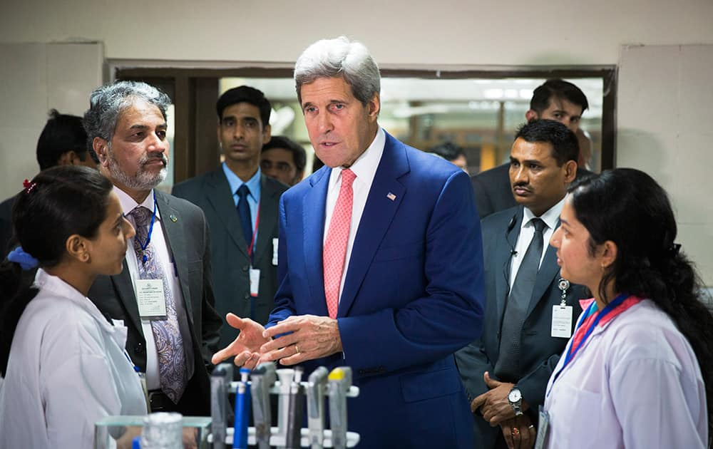 US Secretary of State, John Kerry, speaks with graduate students about their work at the Indian Institute of Technology in New Delhi.