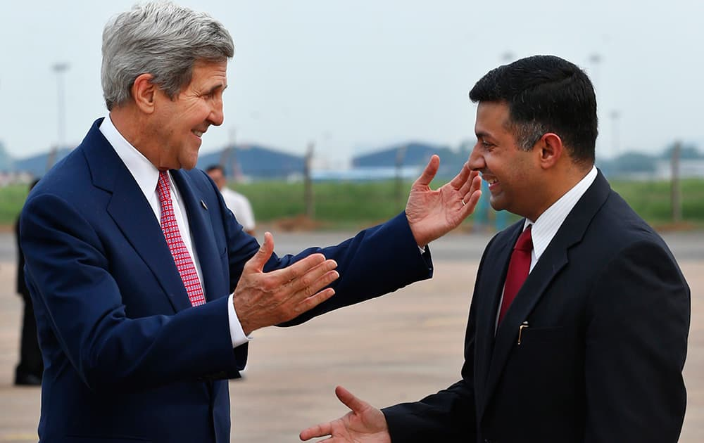 US Secretary of State John Kerry greets Indian Joint Secretary (Americas) Vikram Kumar Doraiswami upon arrival at the airport in New Delhi.