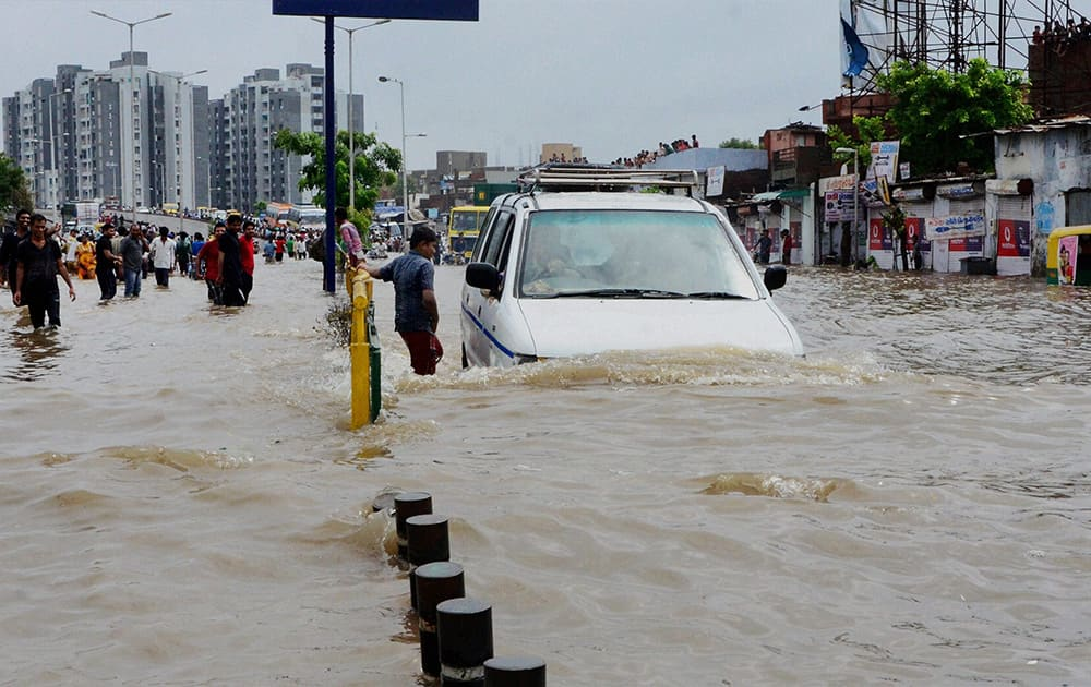 A flooded road after heavy rains in Ahmedabad.