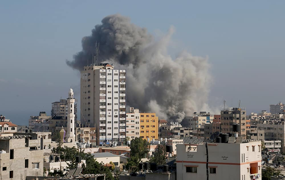 Smoke and fire from the explosion of an Israeli strike rise over Gaza City, amid Israel`s heaviest air and artillery assault in more than three weeks of Israel-Hamas fighting.