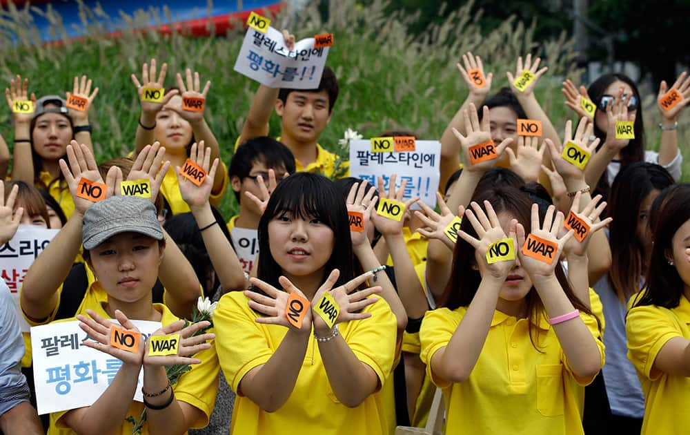 South Korean students hold a rally against the Israeli military operations in Gaza and the West Bank and wish for peace near the Israeli Embassy in Seoul, South Korea.