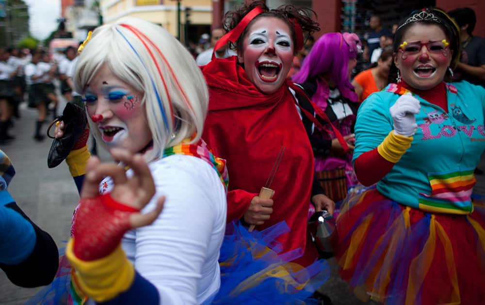 Clowns dance in the Parade of Clowns as part of the sixth annual Latin American Clown Congress in Guatemala.