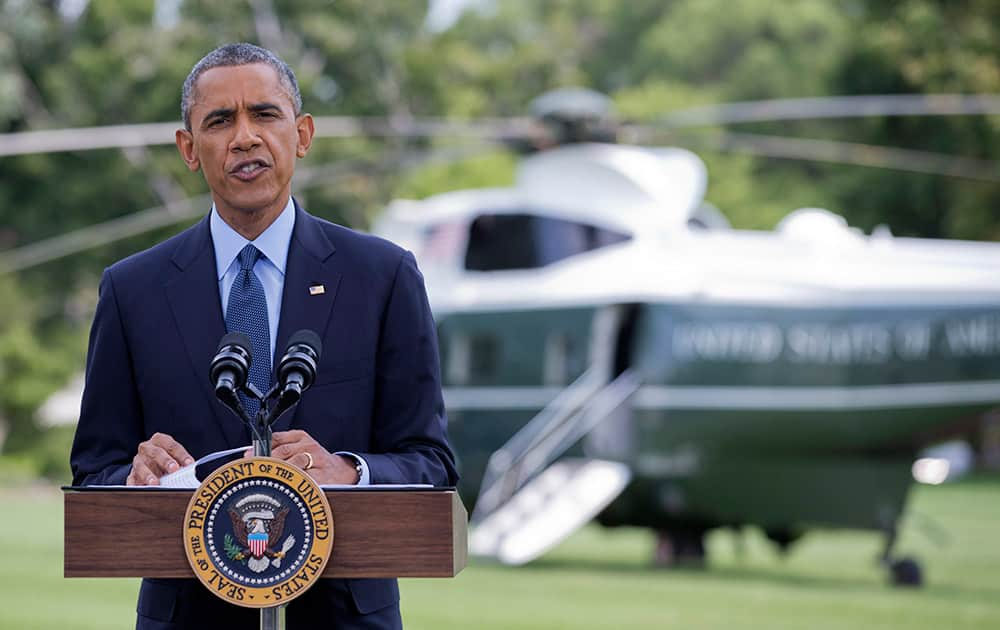 President Barack Obama speaks on the South Lawn of the White House in Washington.