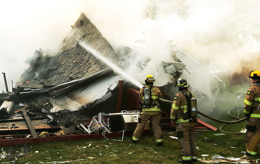 Unified Fire Fighters work on a house fire in Draper.