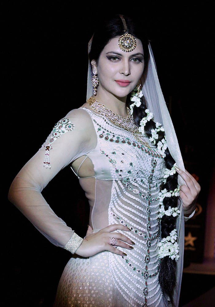Former Miss India Ankita Shorey poses in a jewellery design by Queenie Singh during the India International Jewellery Week (IIJW) in Mumbai.