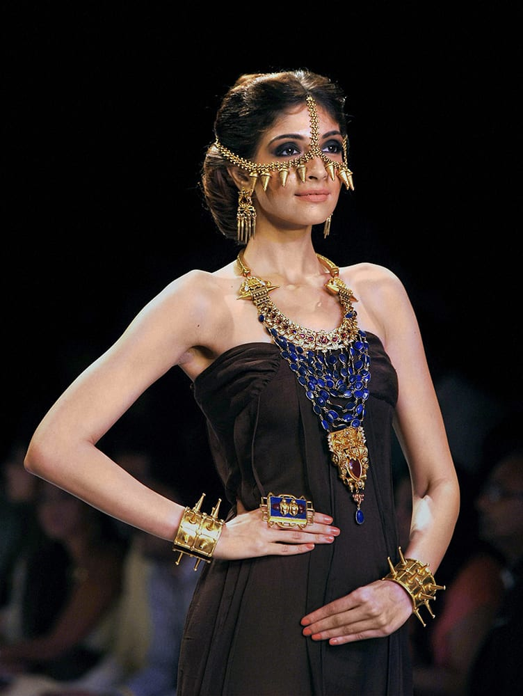 A model walks the ramp during the India International Jewellery Week (IIJW) in Mumbai.