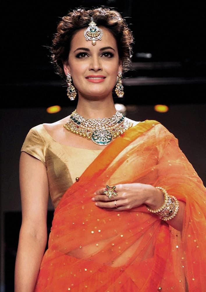Bollywood actress Dia Mirza walks the ramp during the India International Jewellery Week (IIJW) in Mumbai.