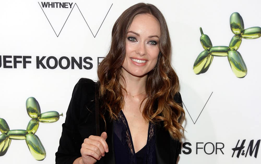 Actress Olivia Wilde attends the opening of the H&M Fifth Avenue flagship store in New York.