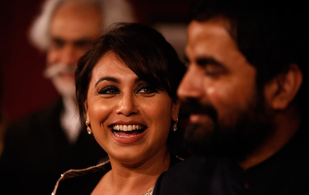 Actress Rani Mukherji smiles as she praises the work of designer Sabyasachi, right, at the India Couture Week, held by Fashion Design Council of India, in New Delhi.