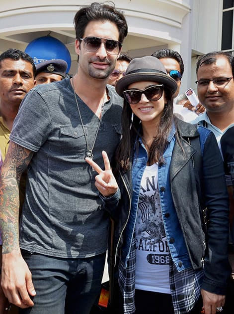 Sunny Leone with her husband Daniel Weber on her arrival at the airport in Jodhpur.