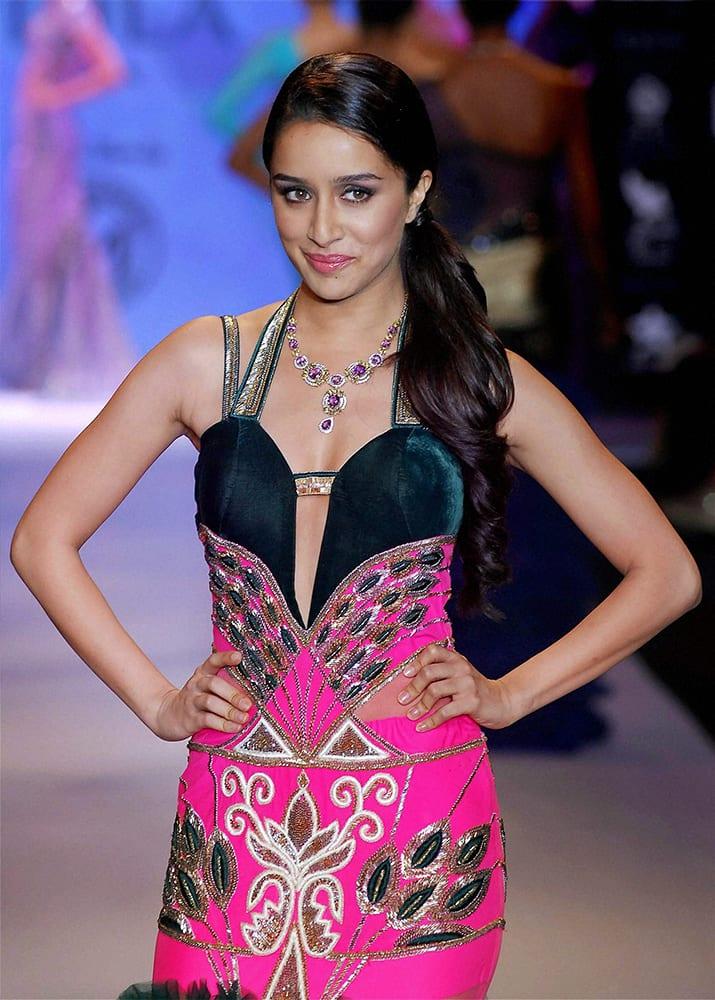 Bollywood actor Shraddha Kapoor displays creative jewellery designs during the India International Jewellery Week (IIJW) in Mumbai.