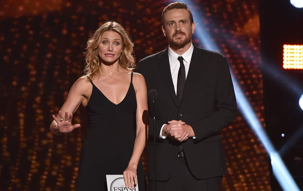 Cameron Diaz, left, and Jason Segel, right, present the award for best breakthrough athlete at the ESPY Awards at the Nokia Theatre in Los Angeles.