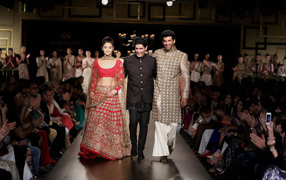 Bollywood actor Alia Bhatt, designer Manish Malhotra and actor Aditya Kapoor at the India Couture Week 2014 in New Delhi.