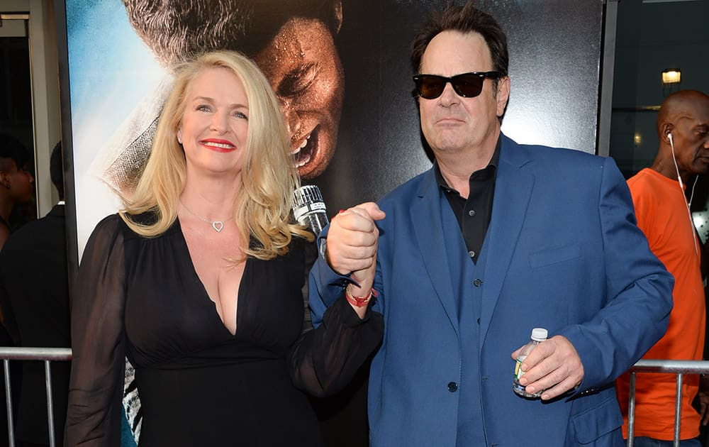 Donna Dixon, left, and Dan Aykroyd attend the world premiere of