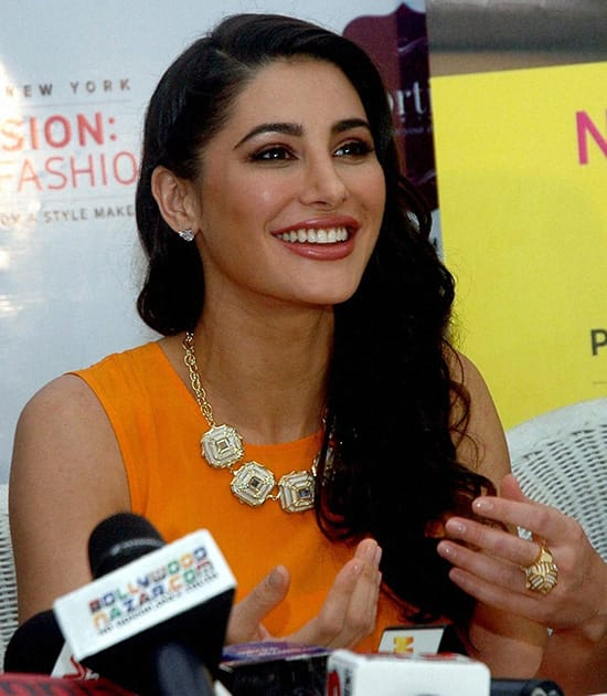 Nargis Fakri interacts with the media during a launch event in Mumbai.