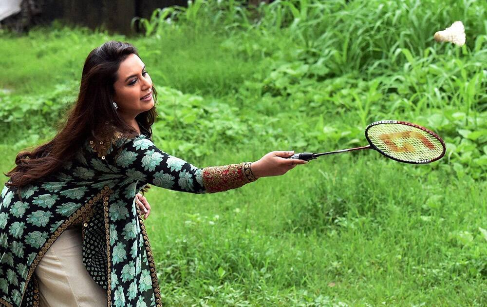 Actress Rani Mukerji plays badminton at a school during a promotional event in Mumbai.