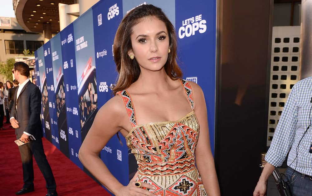 Nina Dobrev arrives at the Los Angeles premiere of 'Let's Be Cops' at the Cinerama Dome.