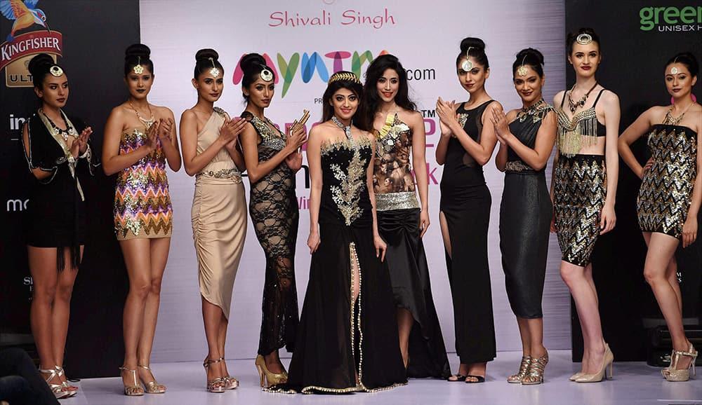 Actor Praneeta Subhash with designer Shivali Singh on the ramp during the first day of Bangalore Fashion Week in Bengaluru.