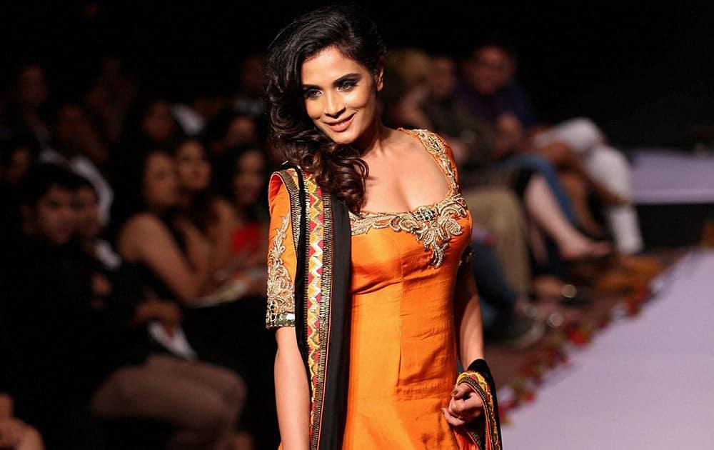 Bollywood actress Richa Chadda showcasing the creation of designer Archanna Kochhar during the 1st day of Bangalore Fashion Week in Bengaluru.
