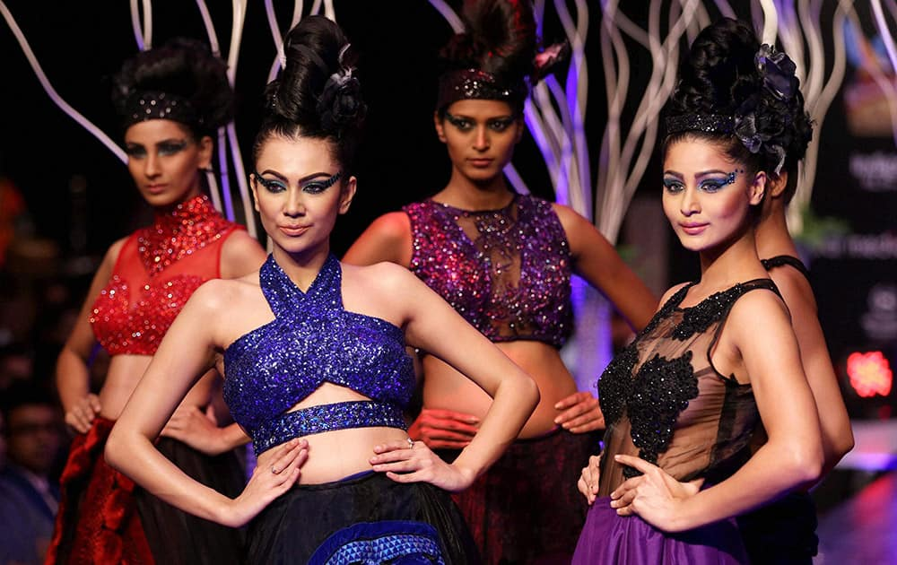 Models walk the ramp as they showcase the creation of designer Ramesh Dembla during the 3rd day of Bangalore Fashion Week.