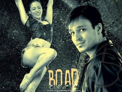 An edge of the seat thriller from Ram Gopal Varma, 'Road' had all the ingredients of a typical road movie. Some exceptional performance by Manoj Bajpayee and Vivek Oberoi make 'Road' an ultimate adventure movie churned out of RGV's factory. - Spice Team