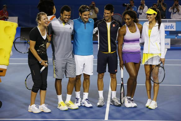 Victoria Azarenka of Belarus, France's Jo-Wilfried Tsonga, Switzerland's Roger Federer, Serbia's Novak Djokovic, Serena Williams of the US and Serbia's Ana Ivanoic pose for a group photo following an exhibition match on Rod Laver Arena during the Kids Tennis Day at Melbourne Park.