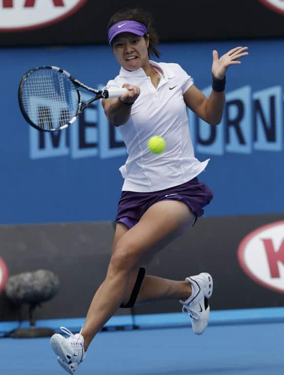 China's Li Na makes a forehand return to Kazakstan's Sesil Karatantcheva during their first round match at the Australian Open tennis championship in Melbourne.