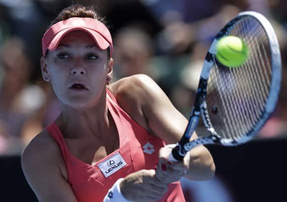 Poland's Agnieszka Radwanska hits a backhand return to Australia's Bojana Bobusic during their first round match at the Australian Open tennis championship in Melbourne.