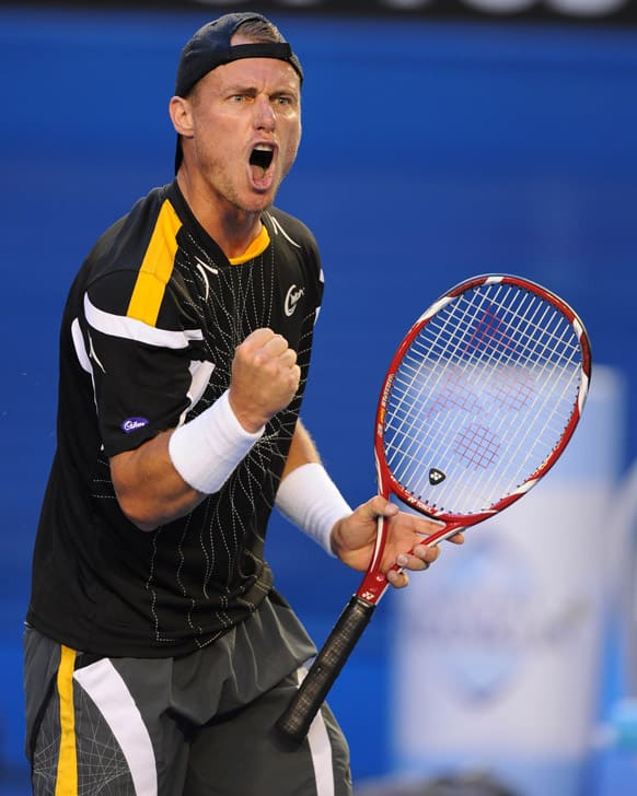 Australia's Lleyton Hewitt reacts during his first round match against Serbia's Janko Tipsarevic at the Australian Open tennis championship in Melbourne.