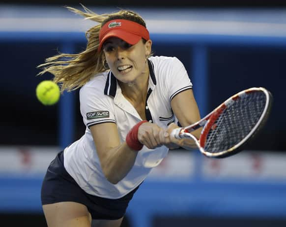 Alize Cornet of France hits a return to Venus Williams of the US in their second round match at the Australian Open tennis championship in Melbourne.