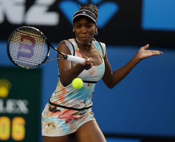 Venus Williams of the US makes a forehand return to Russia's Maria Sharapova during their third round match at the Australian Open tennis championship in Melbourne.