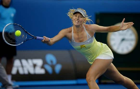 Russia's Maria Sharapova makes a forehand return to Venus Williams of the US during their third round match at the Australian Open tennis championship in Melbourne.