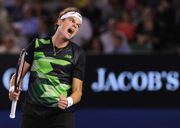 Canada's Milos Raonic reacts during his fourth round loss to Switzerland's Roger Federer at the Australian Open tennis championship.
