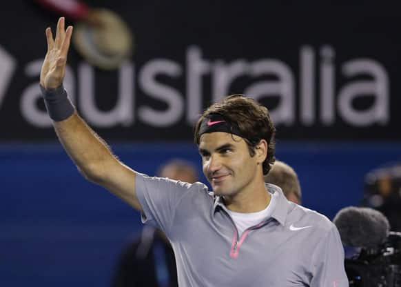 Switzerland's Roger Federer waves to the crowd after his fourth round win over Canada's Milos Raonic at the Australian Open tennis championship.